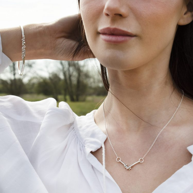Model Wearing Sterling Silver Necklace and Bangle